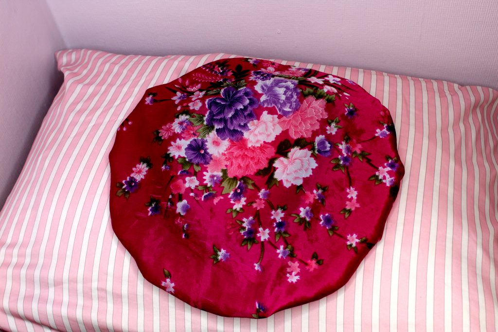 satin or silk bonnet and pillow