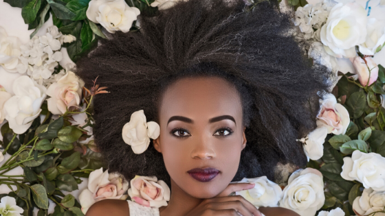 black girl with natural hair and flowers